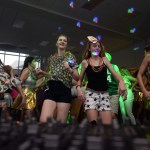 """The crowd of link leaders and freshmen gather together dancing to the """"Cupid Shuffle"""". Photo by Ellie Thoma"""