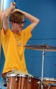Junior Dakota Zugelder raises his arms in preparation to beat the drums. Photo by Katherine McGinness