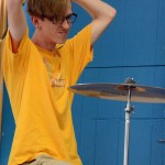 Junior Dakota Zugelder raises his arms in preparation to beat the drums. Photo by Katherine McGinness