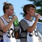 After completing thier timed trials, seniors Bennett Meeds and Sam Thompson take a quick water break in the shade. Photo by Grace Goldman