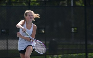 Freshman Libby Hise hits a ball back to her opponent during tryouts. Photo by Reilly Moreland
