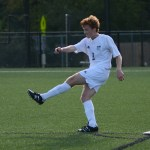 Senior Tommy Nelson kicks the ball to a teammate. Photo by Reilly Moreland
