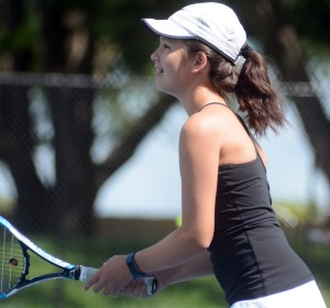 Freshman Kelly Murphy warms up for her match. Photo by Kate Nixon