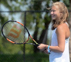 Freshman Grace Helmuth prepares for her warmup. Photo by Kate Nixon