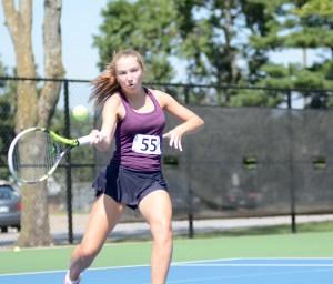 Sophomore Chloe Sowden focuses on hitting the ball with her forehand. Photo by Aislinn Menke