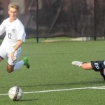 Junior Cooper Holmes steals ball from junior Zach Bass and advances towards the goal. Photo by Izzy Zanone