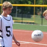 Sophomore Joe VanderLaan juggles the soccer ball before they start tryouts. Photo by Ty Browning
