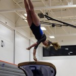 Senior Jessie Stindt does a handspring on full twist off the vault. Photo by Aislinn Menke