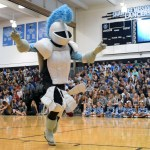 The Lancer Mascot runs around the gym to hype up the students. Photo by Audrey Kesler