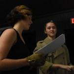 Freshman Gabby MW and junior Katie Caniglia prepare the white board for a scene later on in the play. Photo by Morgan Plunkett