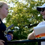 Sophomore Josephine McCray speaks to head coach Andrew Gibbs after her doubles match to report her scores. Photo by Luke Hoffman