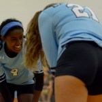 Freshman Hirut Silverman laughs with her teammate. Photo by Luke Hoffman
