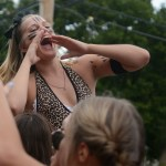 """Junior Addie Von Drehle leads the """"shake that thing"""" chant on the junior float. Photo by Katherine McGinness"""