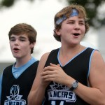 Junior Jack McElroy and sophomore Walter Honnold yell from their basketball float as they go through the parade. Photo by Kate Nixon