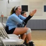 As her teammate Sophomore Sky Hueser scores a point, Sophomore Sydney Crane cheers for her. Photo by Aislinn Menke