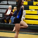Preparing for her double turn on floor, Sophomore Brooklyn Beck steps into a passe. Photo by Aislinn Menke