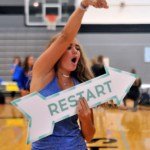 Junior Riley Kimmel advertises her SHARE project by jumping around, dancing, and singing. Photo by Maddie Smiley