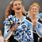 Freshman Stella McKinney spirits towards the crowd after a stunt routine. Photo by Maddie Smiley