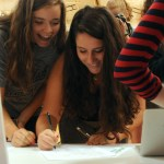 Sophomores Ari Sharman and Alyssa Deering sign up for the Restart KC project. Photo by Izzy Zanone