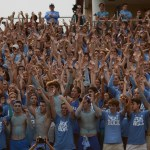 The student section puts their hands up in the air to start a cheer. Photo by Reilly Moreland