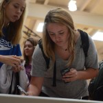 Sophomore Sydney Crane signs up for a SHARE project.