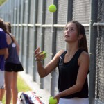 Messing around before the match, sophomore Elli Tucker attempts to juggle the tennis balls. Photo by Ty Browning
