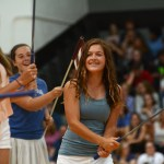 Freshman Katie Hardinger swings her club as a part of the girls golf dance. Photo by Ty Browning