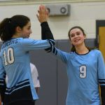 Sophomore Jessica Hickey and freshman Isa Rogler laugh as they sub in. Photo by Hadley Hyatt