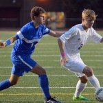 Senior Sam Thompson evades a defender as he takes the ball downfield. Photo by Ally Griffith