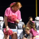 Senior Chloe Krause talks to a little lancer cheerleader during the first half of the football game. Photo by Katherine Odell