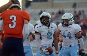 Junior Isaiah Wright and senior Carter Trippel celebrate after Wright receives the ball. Photo by Katherine McGinness
