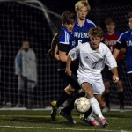 After receiving a pass, junior Cooper Holmes dribbles out of pressure. Photo by Lucy Morantz
