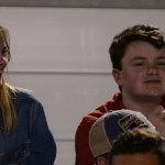 Sophomores Maggie Schutt and Jack Krebs watch the game from the Student Section. Photo by Reilly Moreland