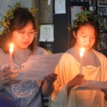 Junior Jia Self and sophomore Lily Turner hold candles after reciting their speeches. Photo by Ally Griffith