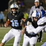 Senior Peyton Wiklund runs the ball down the field and scores a touchdown, making the score 42-17. Photo by Aislinn Menke