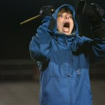 Freshman Zeke Krause hits the cowbell while the band performs in the halftime show. Photo by Aislinn Menke