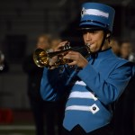 Sophomore Joseph Wagner plays the trumpet during the bands entrance onto the field. Photo by Audrey Kesler