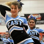 Freshman Zoey Lavern does routine at the cheer competition. Photo by Carson Holtgraves