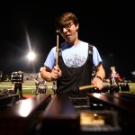 Junior Sam Sokoloff pounds out notes on the xylophone during half time. Photo by Ellie Thoma