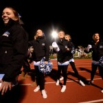 Seniors Lauren Packer, Isabelle Epstein, Carly Dreyer, Chloe Kowalski and junior Megan Packel prepare to throw t-shirts into the crowd at half time. Photo by Ellie Thoma