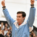 Senior Matt McGannon celebrates the senior's victory in canned food relay class competition. Photo by Ellen Swanson