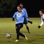Senior Ian Scutt passes the ball up the field. Photo by Lucy Morantz