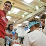 After Safferstein complains of the taste and asks for water, senior Reser Hall laughs. Photo by Lucy Morantz