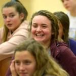 Sophomore Sydney Crane laughs during the girls basketball presentation. Photo by Luke Hoffman