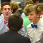 Juniors Carson Jones and Kevin Grinstead listen to a story told by their teammate. Photo by Luke Hoffman
