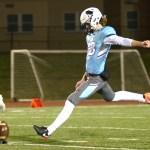 Junior Parker Willis kicks off to the Mustangs. Photo by Luke Hoffman