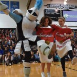 The Lancer mascot, sophomore Reilly Moreland and senior Riley McCullough kick their legs in a chorus line while senior Denny Rice gets his legs waxed. Photo by Morgan Plunkett