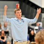 Senior Thomas Luger balances a can on his head during a relay. Photo by Maddie Smiley