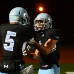Senior Zach Yeo attempts to calm down Senior Kelyn Bolton after a fight breaks out in the end zone. Photo by Ty Browning