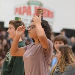 Sophomore Samantha Glidewell tries to balance a can on her head during a competition. Photo by Ty Browning